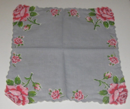 Gray vintage hankie with red and pink flowers.