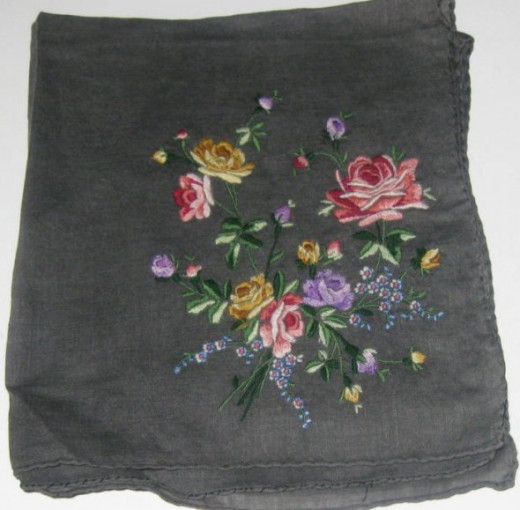 Unusual black handkerchief with embroidered flowers.