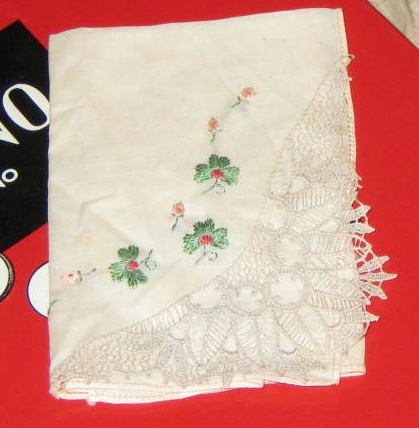 Vintage hankie with embroidery and tatted corner.