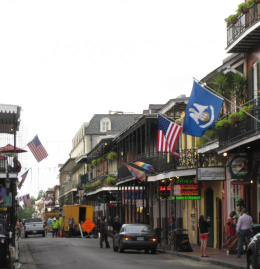 A view of a busy street in the French Quarter of New Orleans.