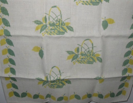 Baskets with fruit on linen tea towel.