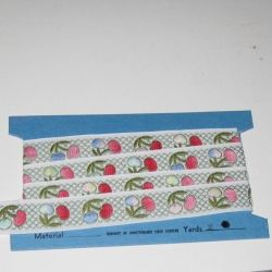 Embroidered trim with cherries.