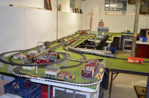 Thanks to Lithonia Lighting T12 Fluorescent Fixtures, my well lit workshop and model railroad area.