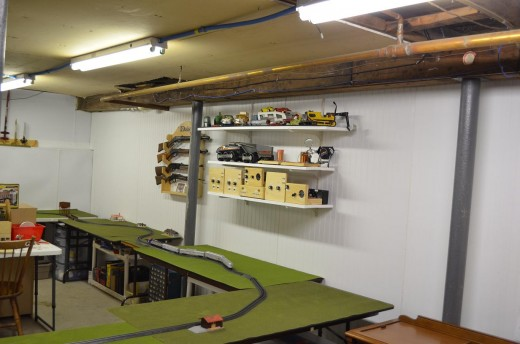 Thanks to Lithonia Lighting T12 Fluorescent Fixtures, my well lit basement workshop and model railroad area.