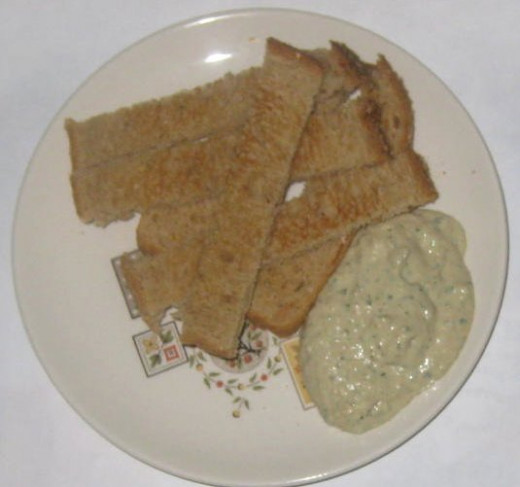 Hummus and toast strips. So easy and a nice change from hummus and crackers. Toast your bread, cut into strips, and dip into your hummus.