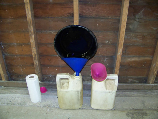 Drain the oil into an appropriate container. I use an empty kitty litter container to store the old oil until I recycle it.