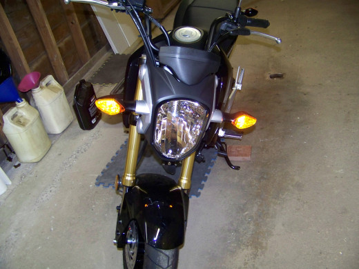 Turn the ignition switch to the On position but do not start Grom. Side marker lights should illuminate but not headlight. Check front turn signals.