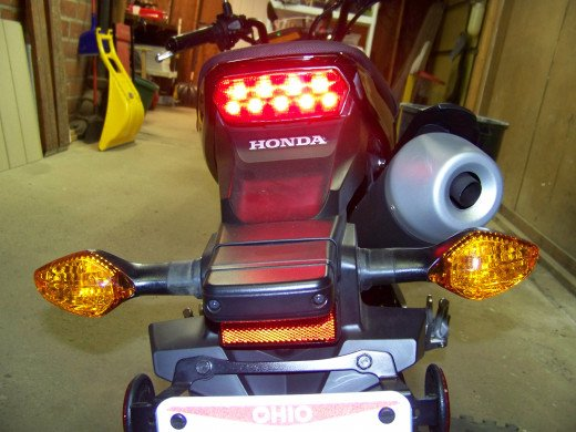 Rear taillight marker should illuminate. Turn signals on the back do not have marker filaments.