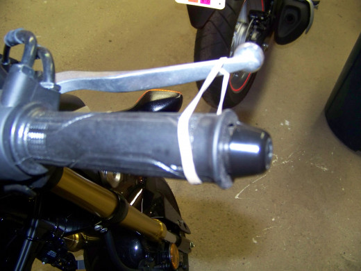 I put a rubber band around brake lever, this applies just enough pressure to actuate the rear brake light.