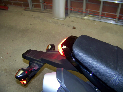You can just see the rear brake light illuminated from the side when you use your foot to actuate the rear brake lever.