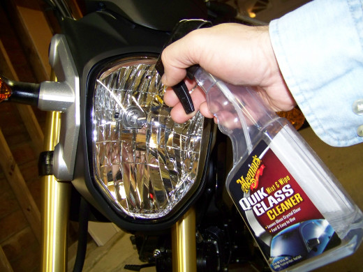 I use Meguiar's Quik Glass Cleaner with a clean chamois on the headlight, front and rear turns signal lenses, mirrors, and instrument panel lens.