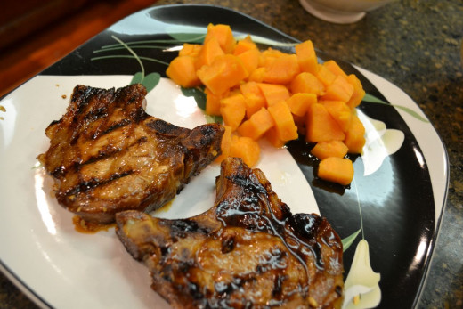 Pork chops cooked on an indoor grill pan.
