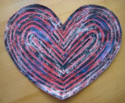 Bling up your cut-out valentine by using glitter glue to attach it to the contrasting paper.