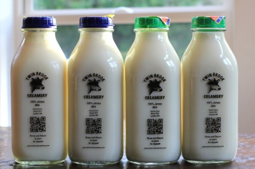 organic milk in square glass containers