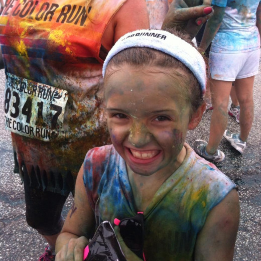 My daughter smiling after completing her first Color Run in 2013. She has since ran the 5K twice.