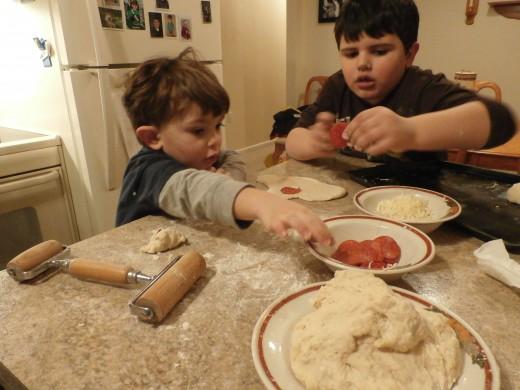 The boys making pepperoni rolls