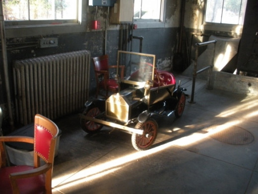 This miniature car, which can be seen from the garage's window even when the place is shut, doesn't have anything to do with Thomas Edison. A nearby resident has lent it to the park service, and the rangers take it out once in a while for children to