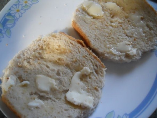 The bread was place in the pie iron and trimmed.   Take the trimmed bread and butter it on one side.