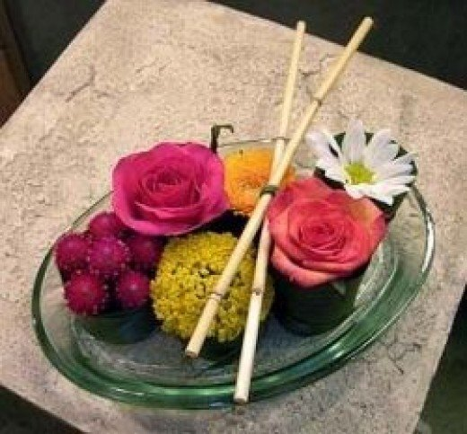 A floral arrangement made to look like a plate of sushi