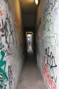 A narrow alley painted with graffiti