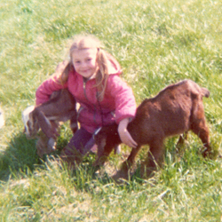 Six year old girl and her goats