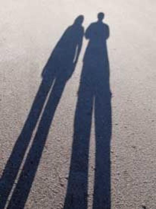 A couple casting long shadows