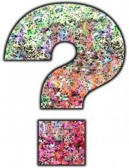 Color spattered question mark in green, pink, purple, and black