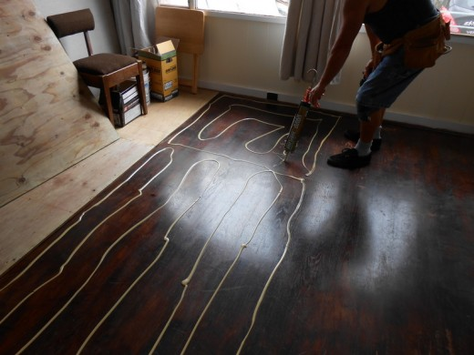 Prepping to lay down new subflooring over existing hardwood. Damage too extensive on original flooring. More cost effective to lay down new hardwood.