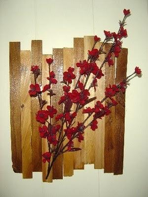 Wood shims + glue gun + silk flowers = Cheap Shim Chic. How to link below.