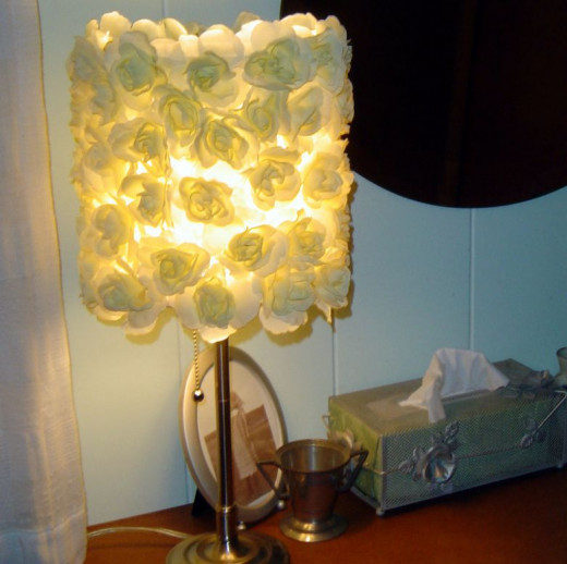 VERY inexpensive and pretty, don't you think? This is the DIY silk rose lampshade featured in the intro. Tutorial link found below.