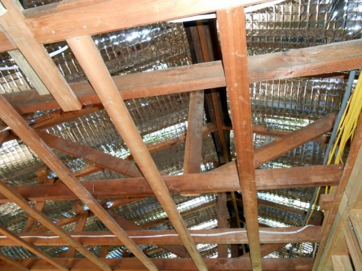 Heat deflecting shields in place in ceiling rafters. They really make a difference in regulating the temperature inside our cottage.