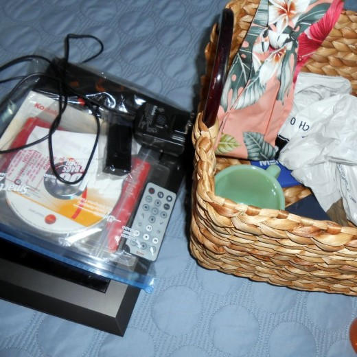 I ended up with a basket with a few things to list on Etsy and others for donation and one to-do task which is updating the Kodak digital photo frame.