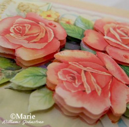 3D effect of a decoupaged paper rose built up in layers