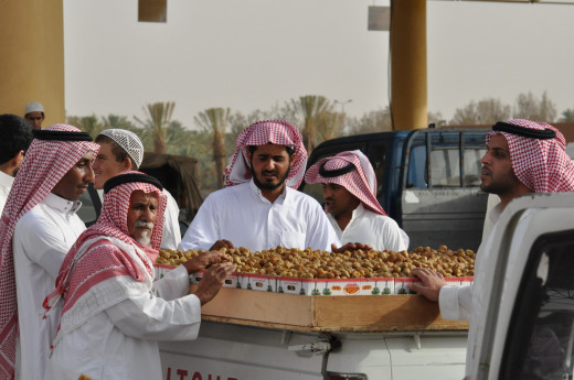 Middle class Saudi traders carry wide range of things on a pickup and sell on streets.