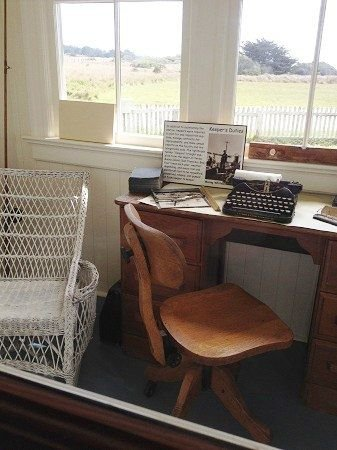 Caretaker's desk overlooks the yard and preserve, with windows on two sides for views of the lighthouse and Pacific Ocean