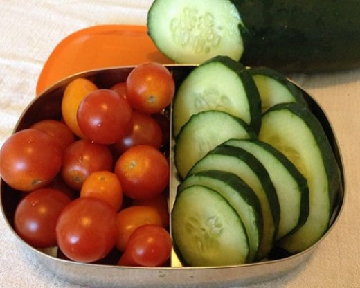 Simple fair that is tasty and colorful, like these assorted tiny tomatoes and cucumber wheels makes for a quick, easy start to a delectable picnic