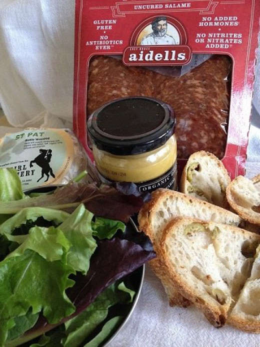 Wash a handful of fresh garden greens, tuck in small container of organic mustard, a package of salami, a soft artisan cheese and a baguette, and you've got a picnic in less than 10 minutes