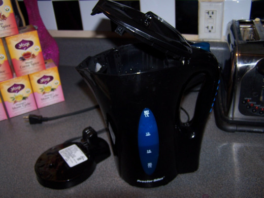 The tea kettle and the base.  The kettle can be safely set on any surface even when the water is boiling hot.