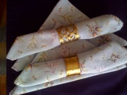 Cloth napkins in napkin rings - Copyright L Kathryn Grace, all rights reserved