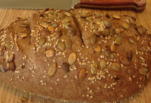 We especially like our loaves sprinkled with healthy, organic seeds; I often use a pumpkin-sesame-flax mixture I stir up myself
