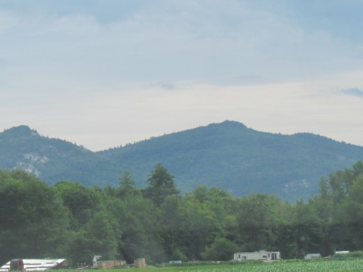 Beautiful mountains surrounded its inhabitants daily in New Hampshire.