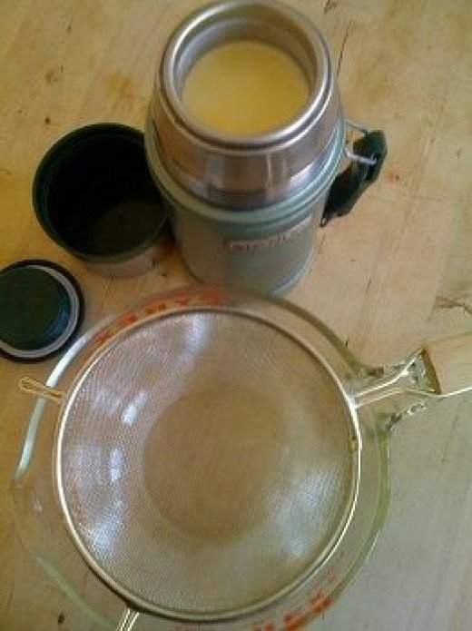Chilled homemade yogurt in thermos, ready to strain