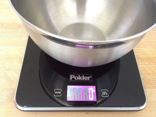 If measuring ingredients directly into a mixing bowl, press the tare button to zero out the bowl weight; press On/Off to switch from ounces to grams