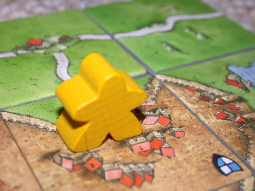 "Close-up of a playing piece, called a ""follower"" or a ""meeple"".  CC BY-SA 3.0http://en.wikipedia.org/wiki/File:Carcassonne-meeple.jpg"