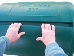 In the Sun-Mar 200, add compostable material by sliding the input door. Mix and aerate the compost by rotating the drum with the help of several finger friendly slots on the outside of the drum.
