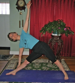 Triangle pose on yoga mat