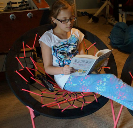 Rachel thinks that a Bungee Chair is a great place to sit and read a book.