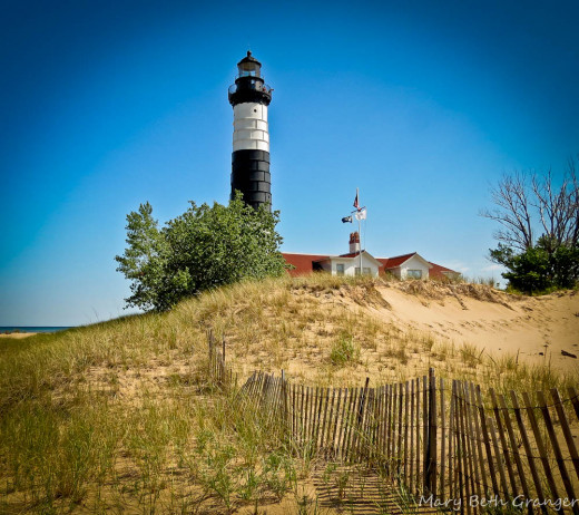"""This is Big Sable Lighthouse.  It is a tall lighthouse with a house attached, perhaps a bit bigger than the one in """"The Lighthouse Mystery"""". mbgphoto"""