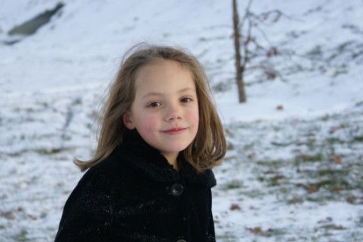 My granddaughter, Rachel enjoying a Missouri snowfall.  Rachel and her sister Ella were visiting from Atlanta.