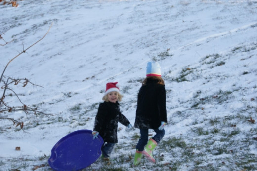 This was Rachel and Ella's first time to go sledding.  Opportunities to play in the snow are very scarce in Atlanta so they were enjoying the snow on their visit to Missouri.